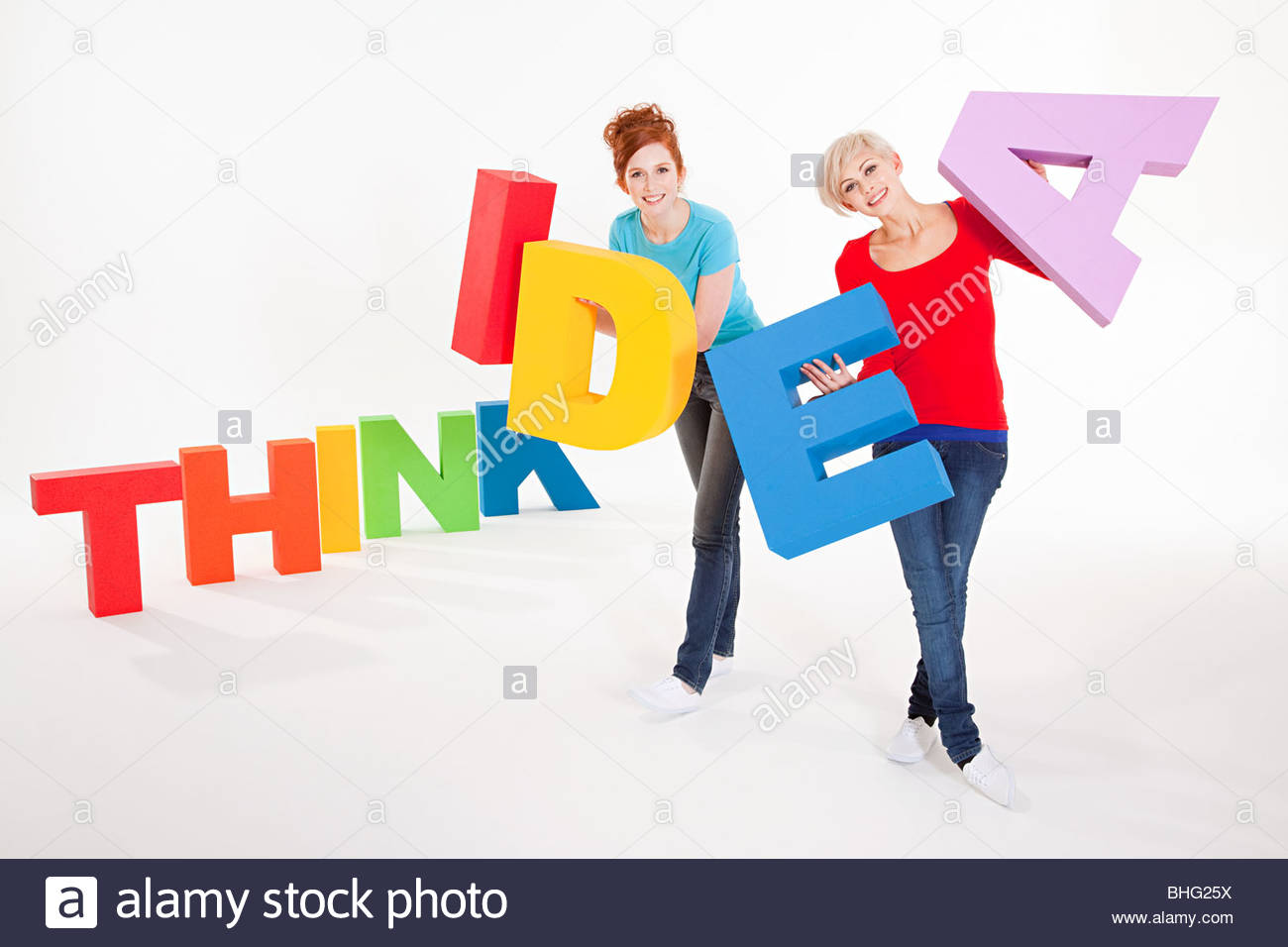 Women with words think and idea - Stock Image