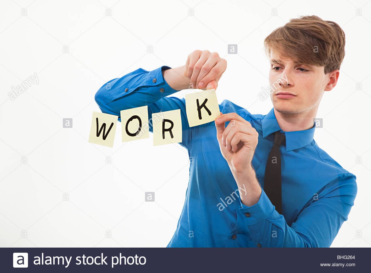 Man spelling work with adhesive notes - Stock Image