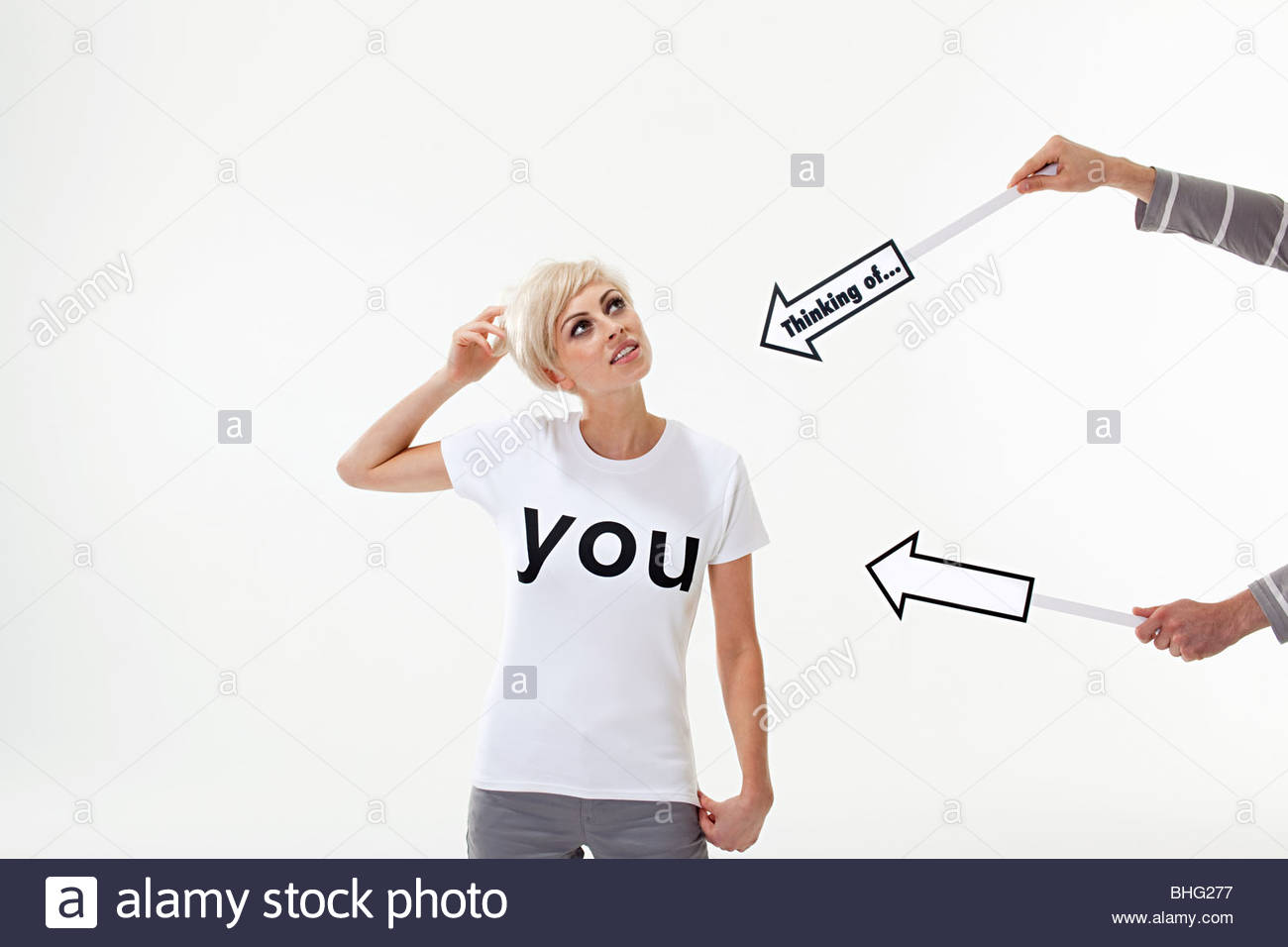 Person pointing signs at young woman - Stock Image