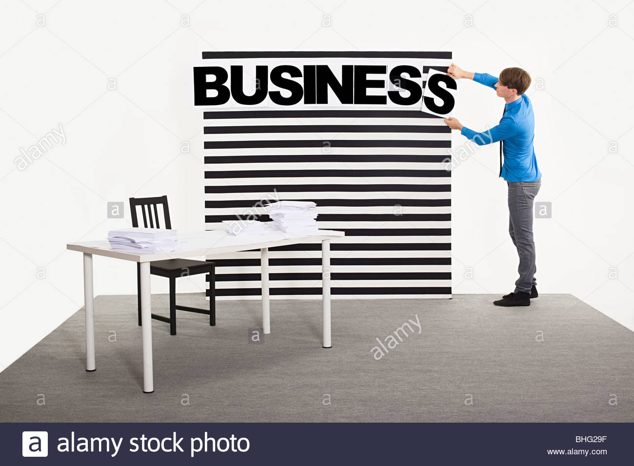 Office worker spelling business - Stock Image
