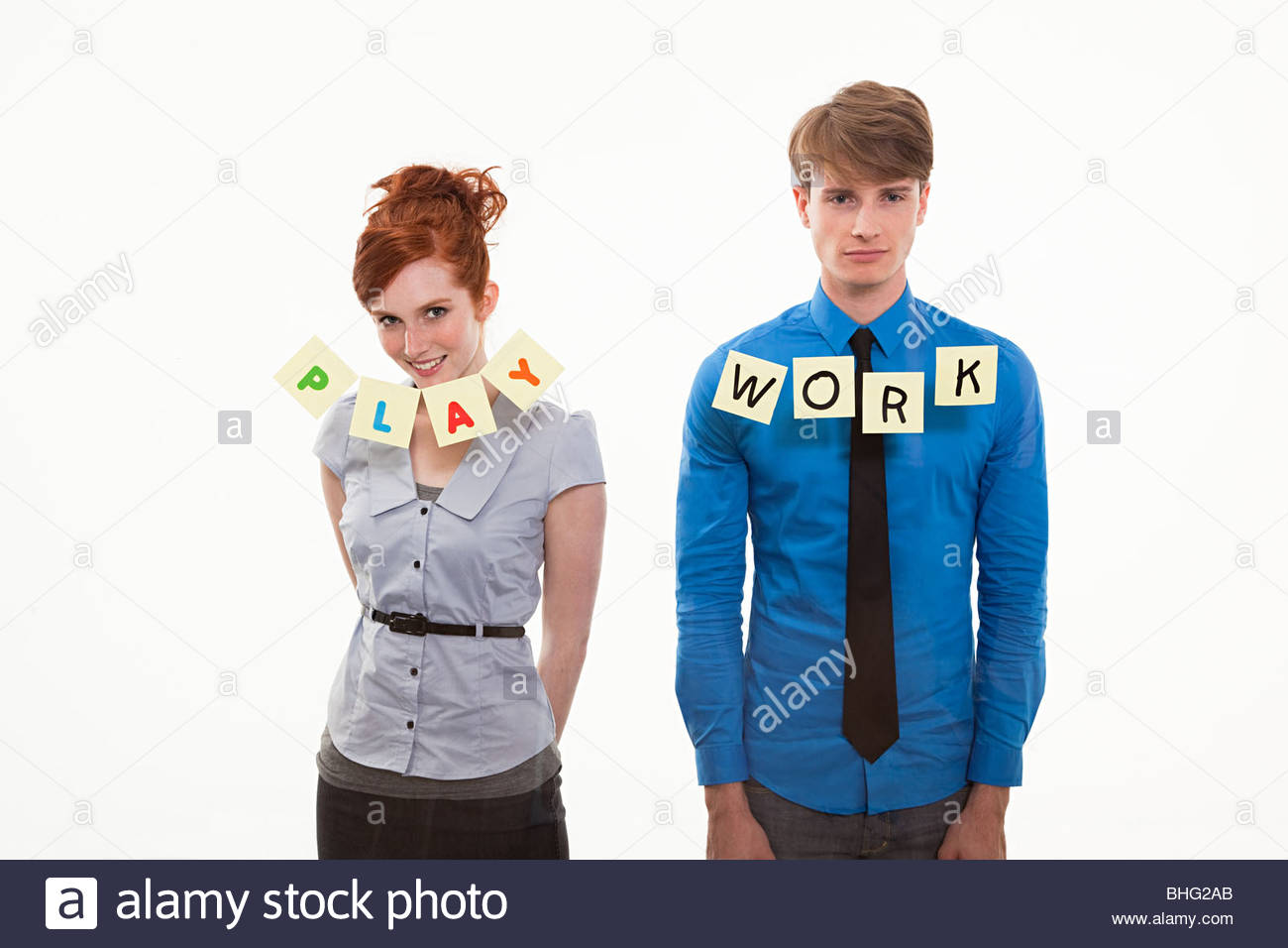 Couple with notes saying work and play - Stock Image