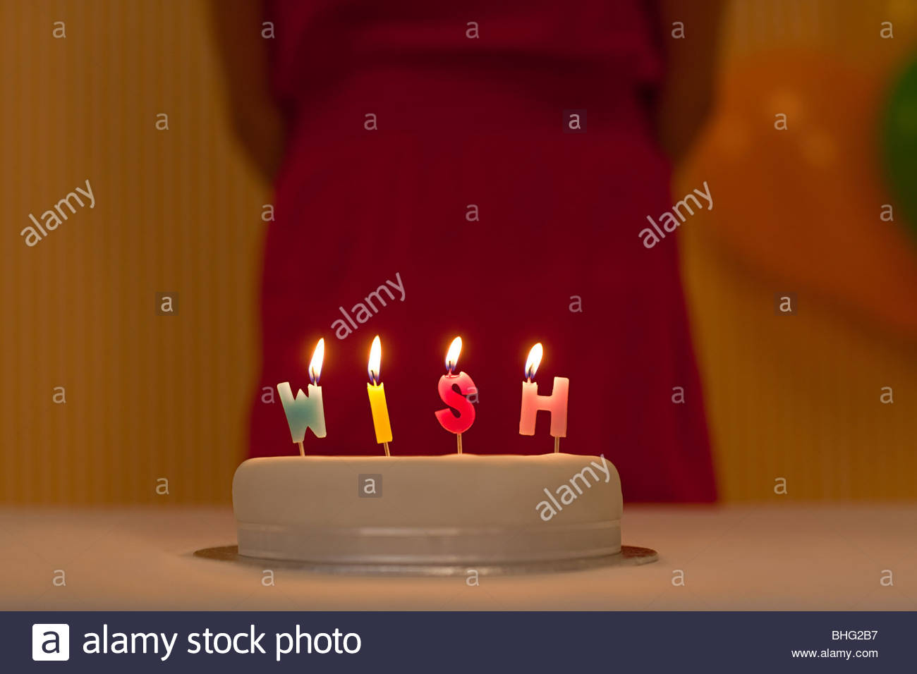 Birthday cake with wish written in candles - Stock Image