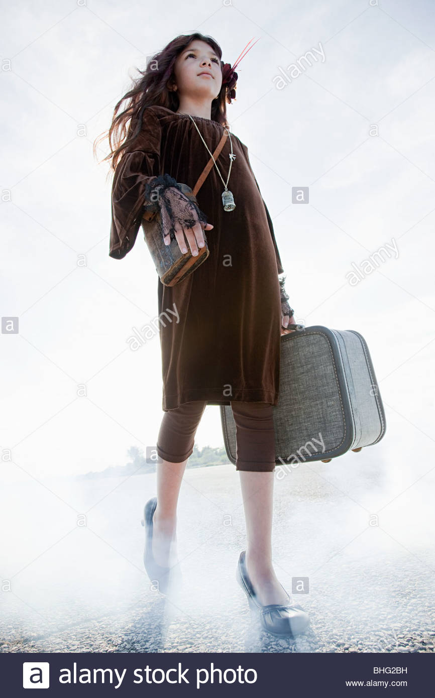 Girl with a suitcase - Stock Image