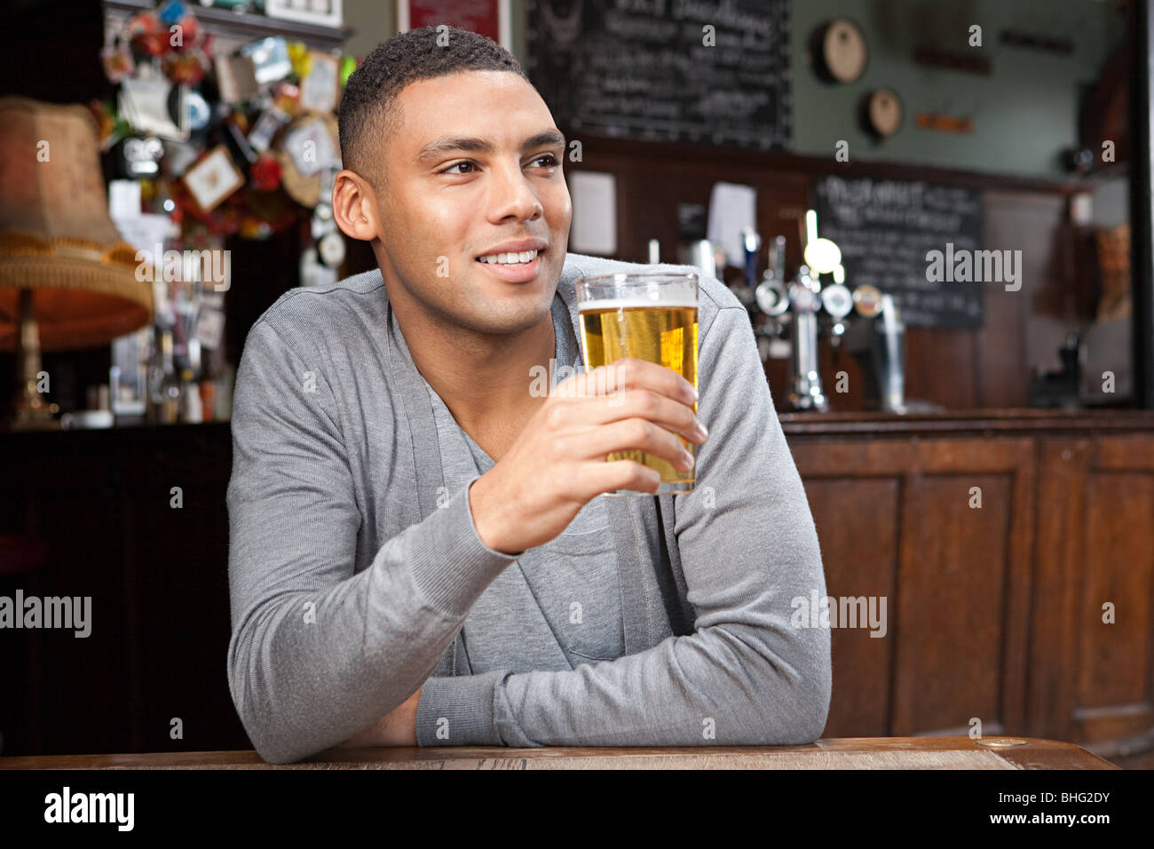 Young man in bar Stock Photo