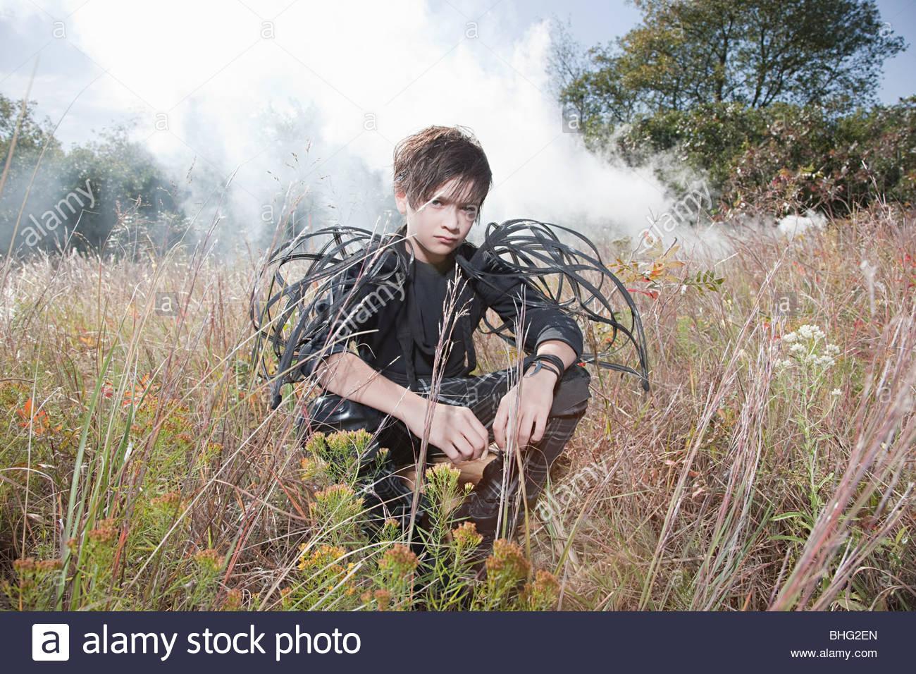 Boy wearing unusual costume - Stock Image