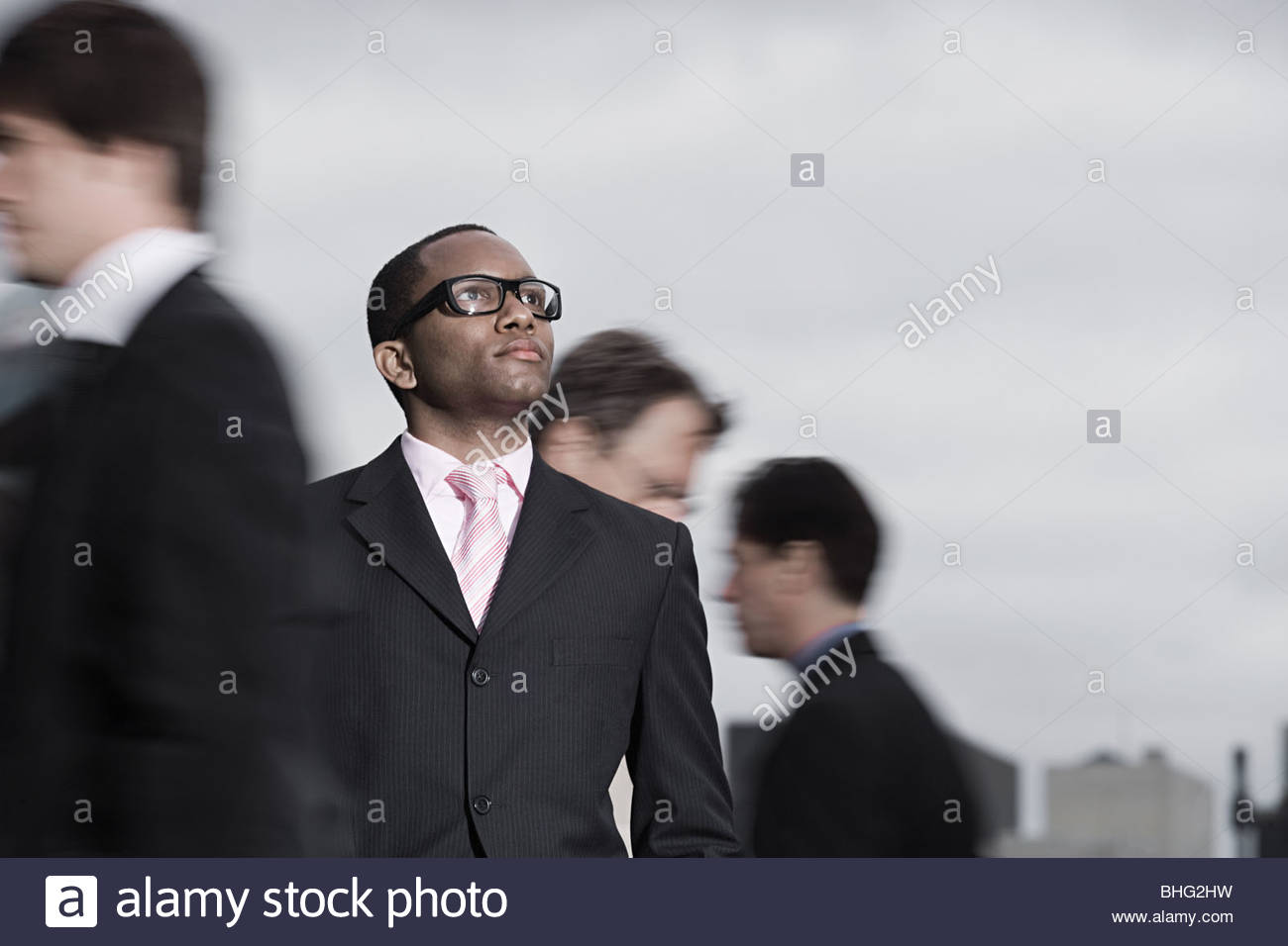 Businessman and people walking - Stock Image