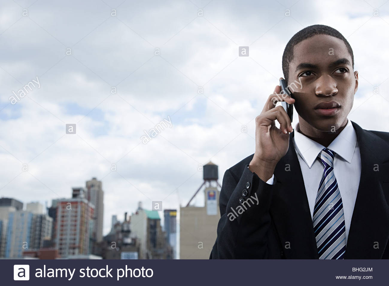 Businessman using cellphone - Stock Image
