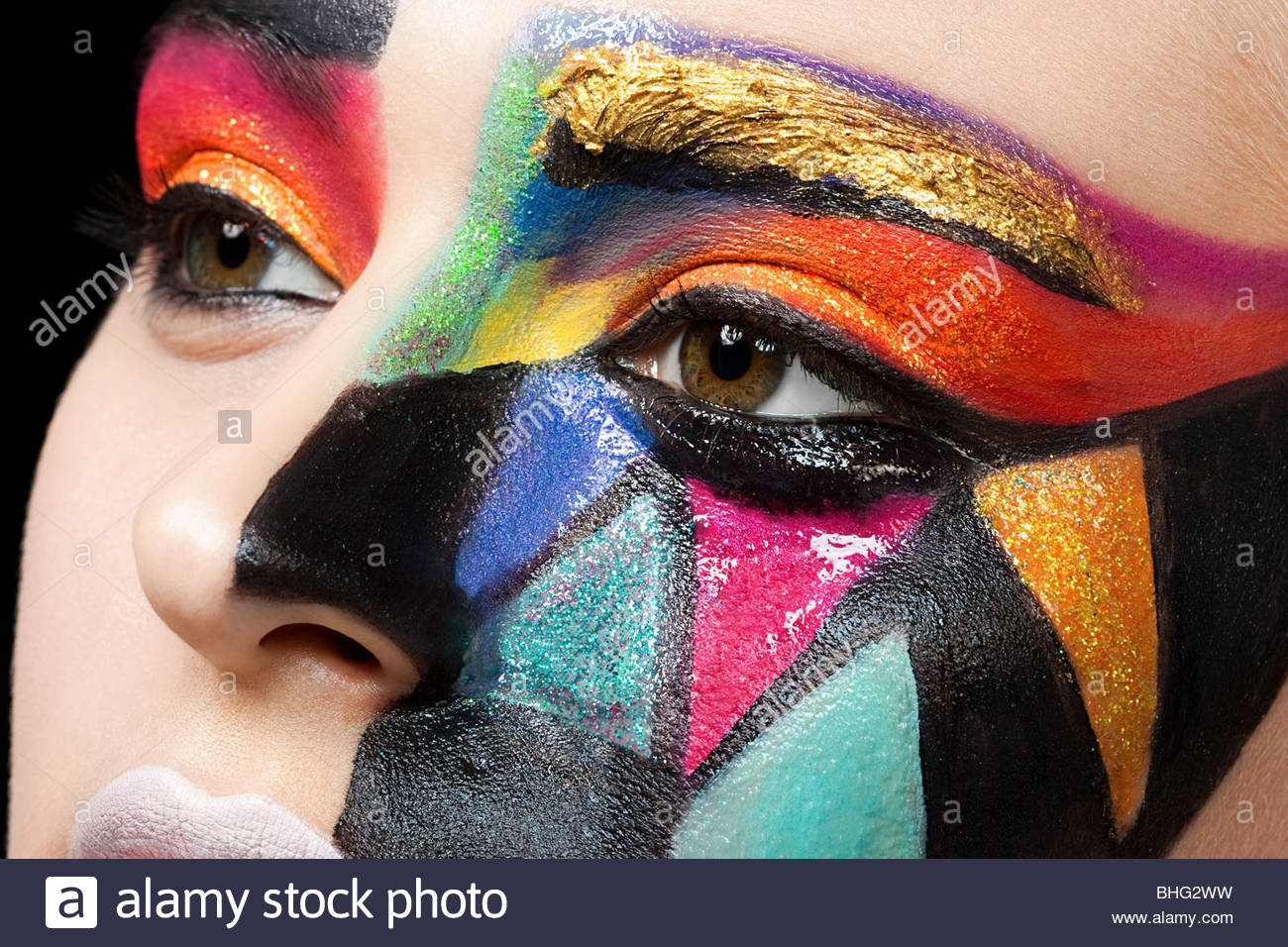 Woman with colourful pattern on face - Stock Image