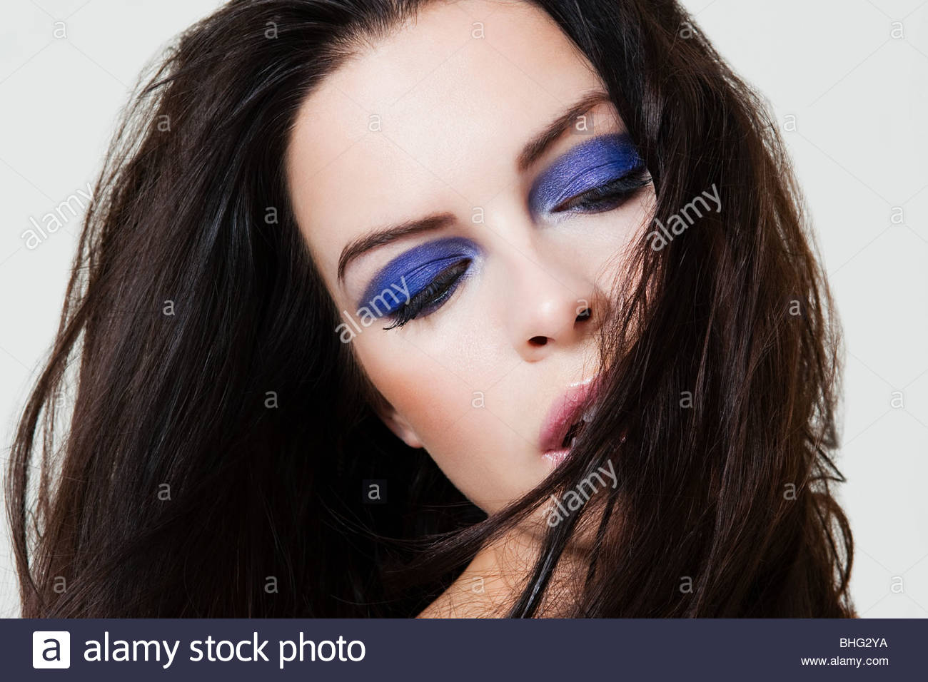Young woman with purple eyeshadow - Stock Image