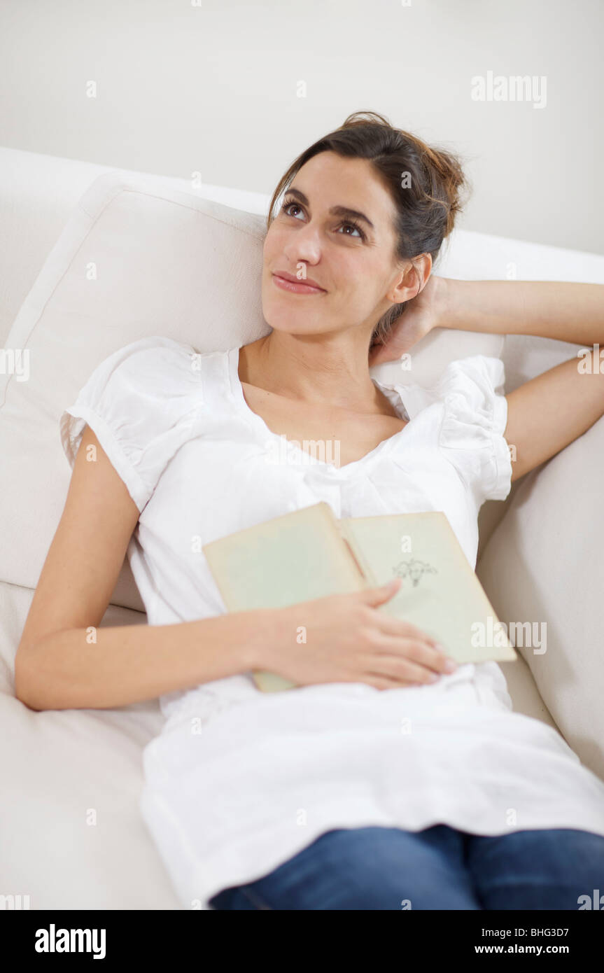 a woman daydreaming - Stock Image