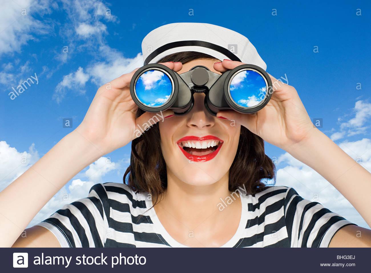 Woman with binoculars - Stock Image