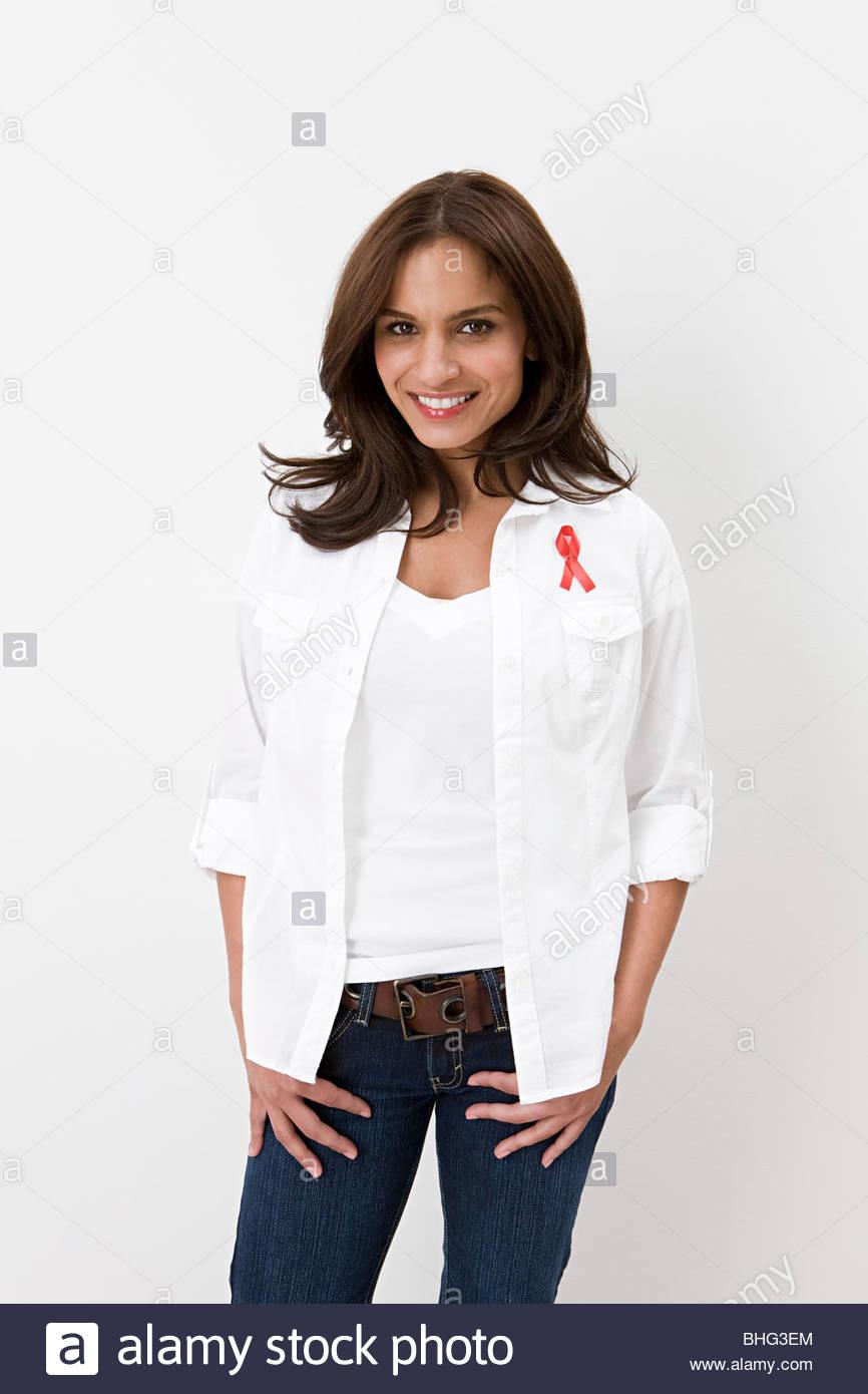 Woman wearing aids awareness ribbon - Stock Image