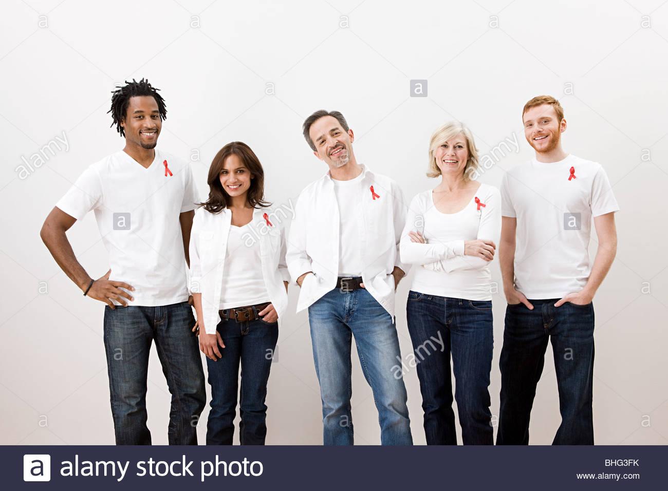 People wearing aids awareness ribbons - Stock Image