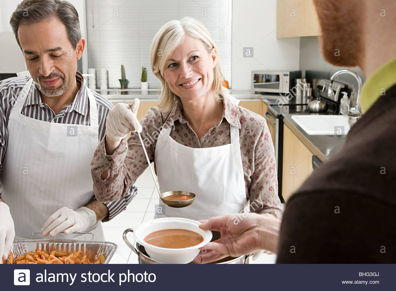 People Volunteering At Soup Kitchen Stock Photo: 28013570 ...