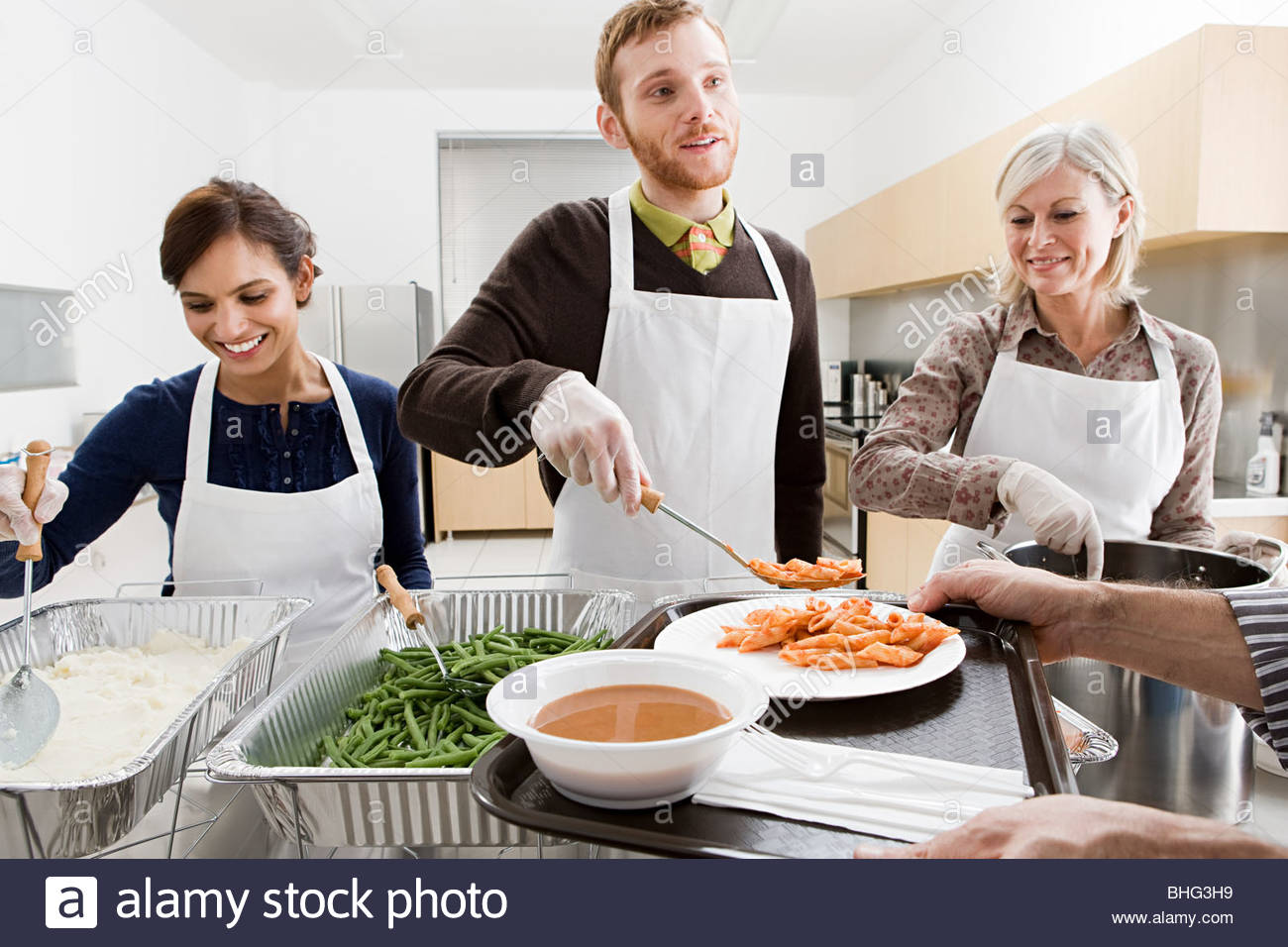 People volunteering at soup kitchen Stock Photo: 28013589 - Alamy
