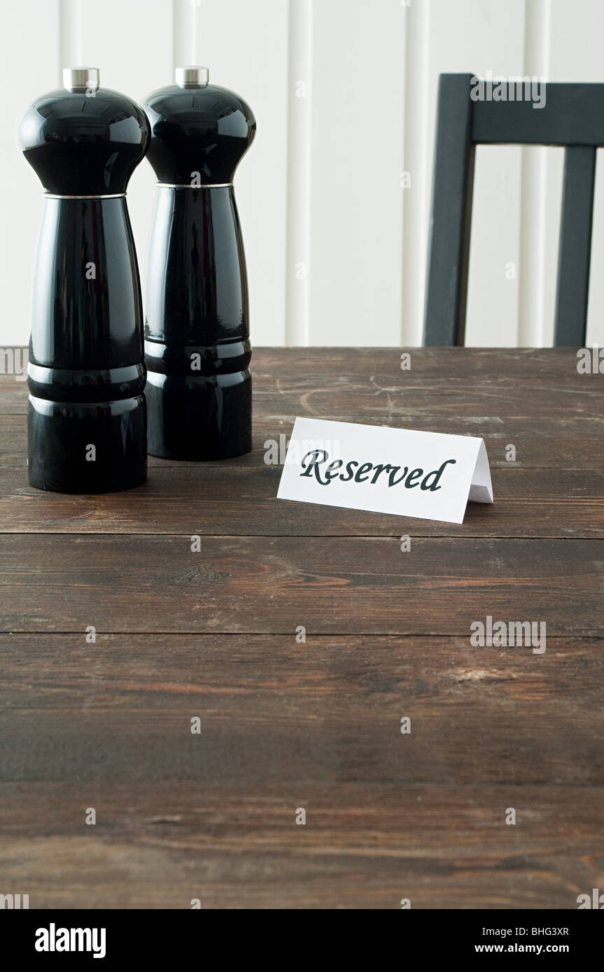 Salt and pepper mills and reserved sign - Stock Image