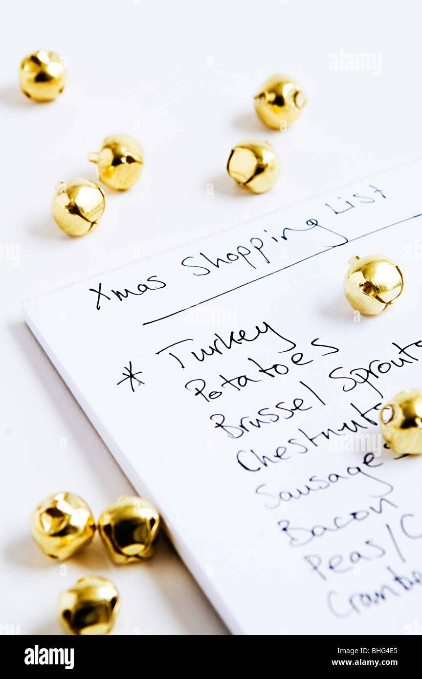 Christmas shopping list and baubles - Stock Image