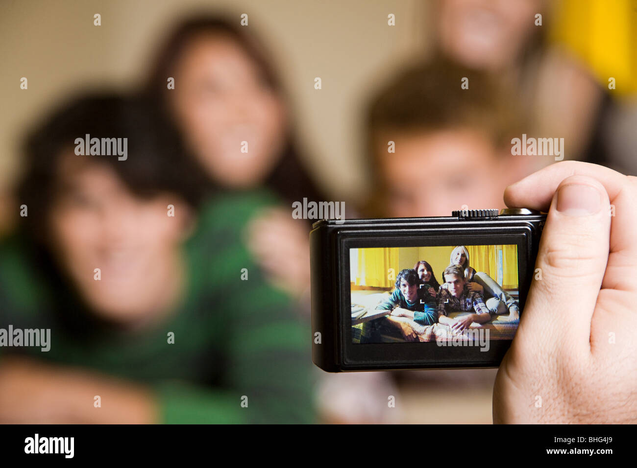 Friends being photographed - Stock Image