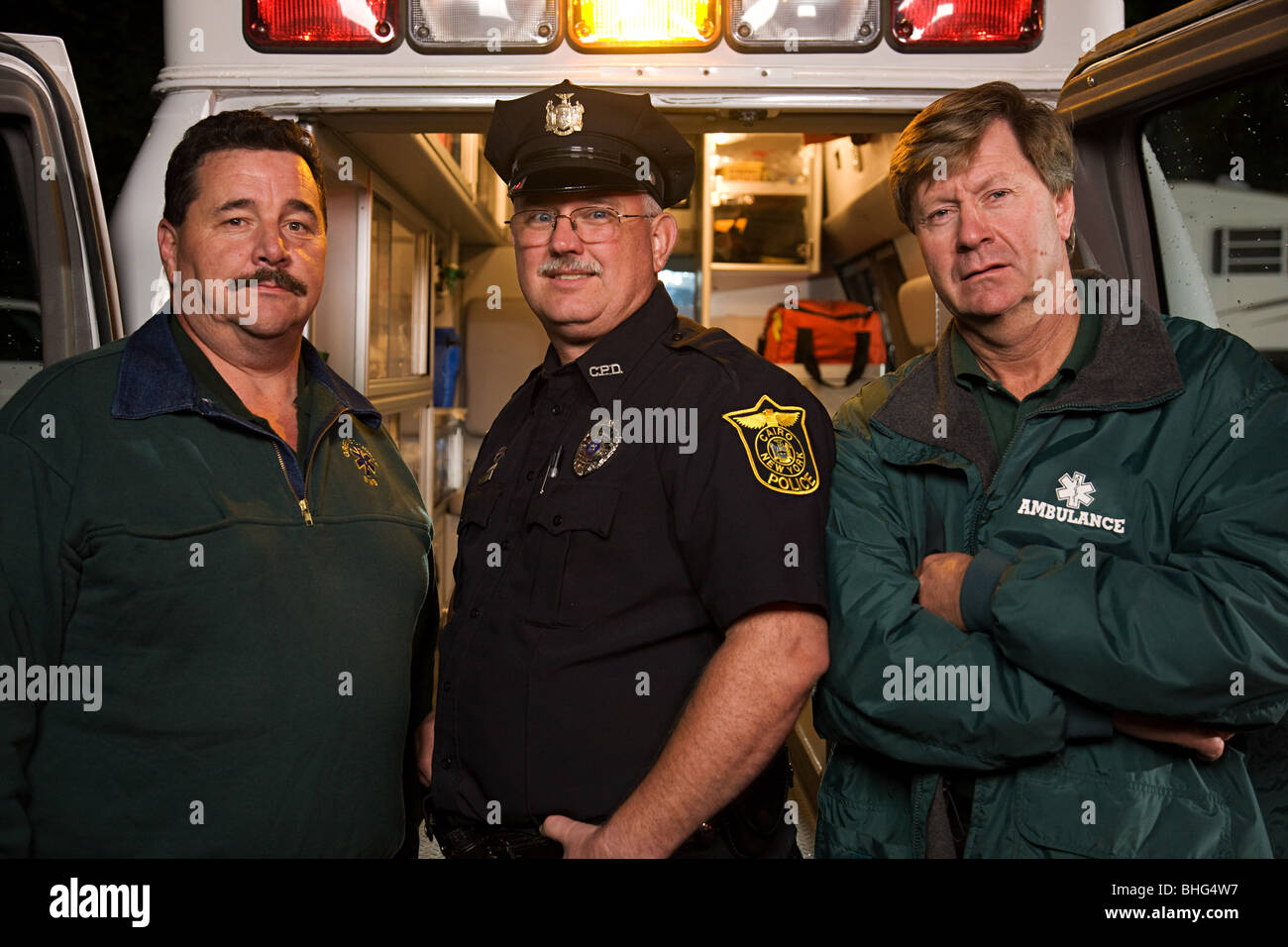 Policeman and emergency medical technicians - Stock Image