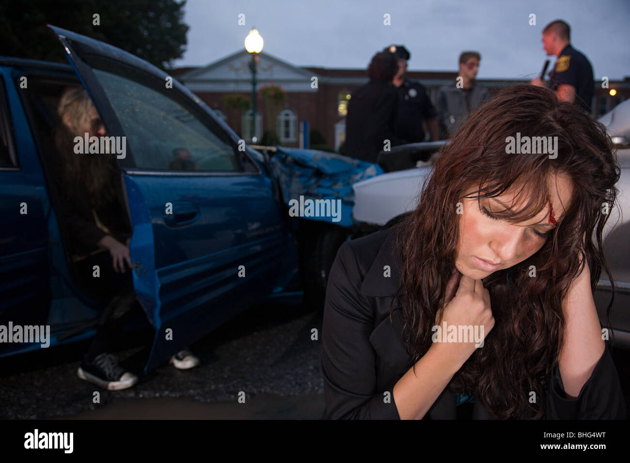 Teenage girl involved in a road accident - Stock Image