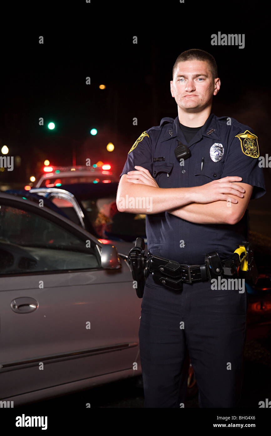 Police officer at scene of accident - Stock Image