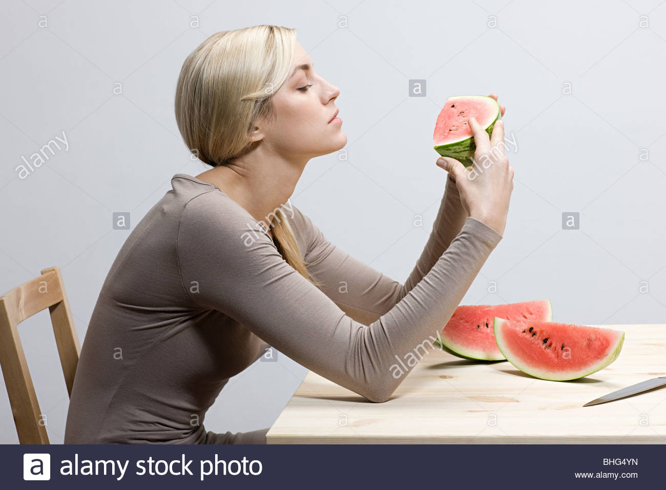 Woman with watermelon slices - Stock Image