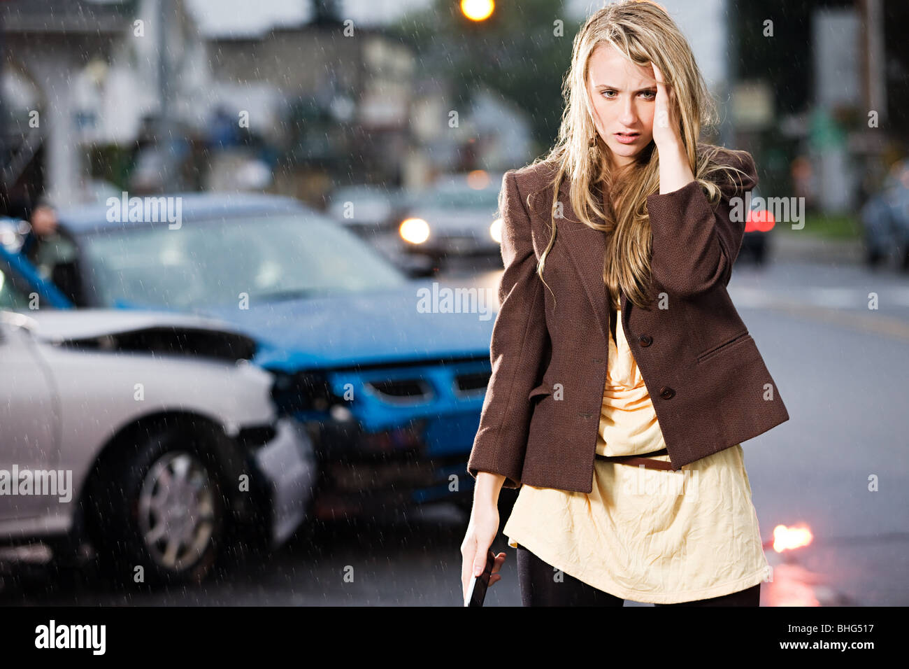 Young woman who has been in an accident - Stock Image
