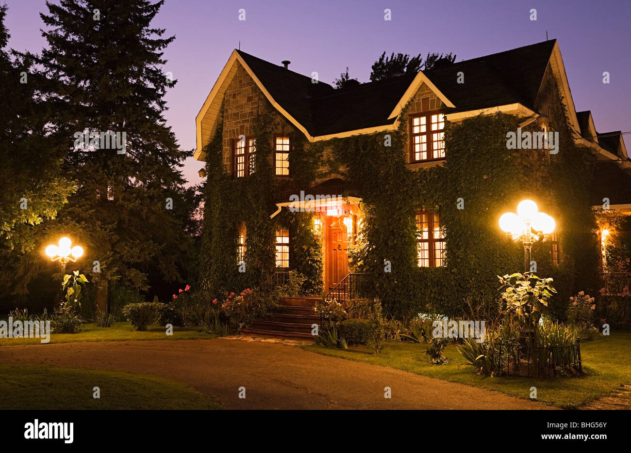 Detached house with lights - Stock Image