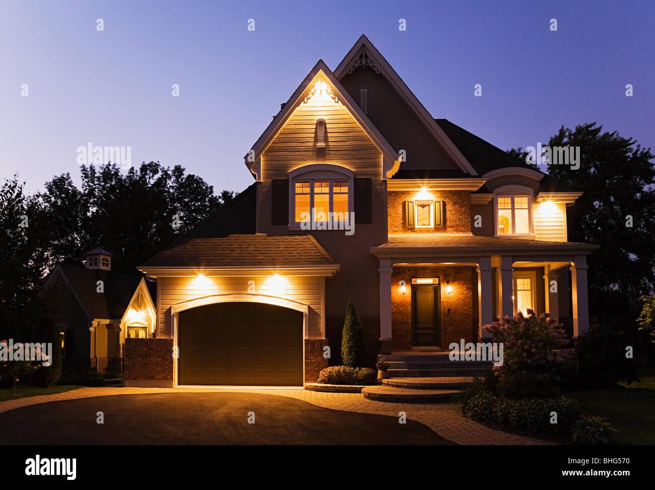 Detached house illuminated - Stock Image