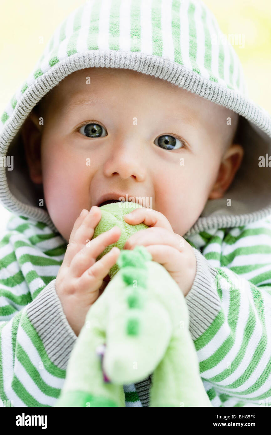 baby with dino-toy - Stock Image