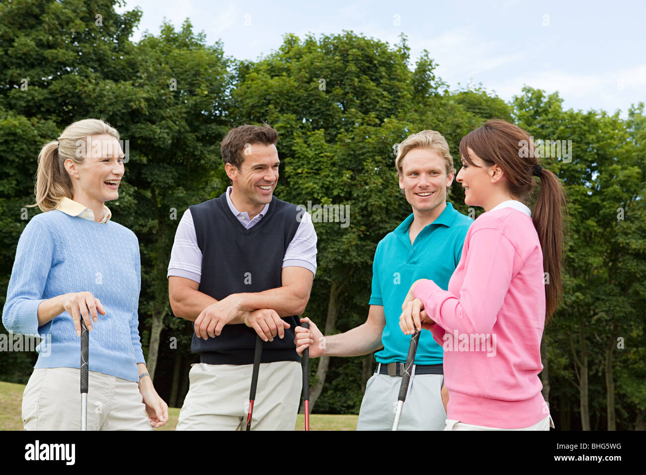 Four golfing friends - Stock Image