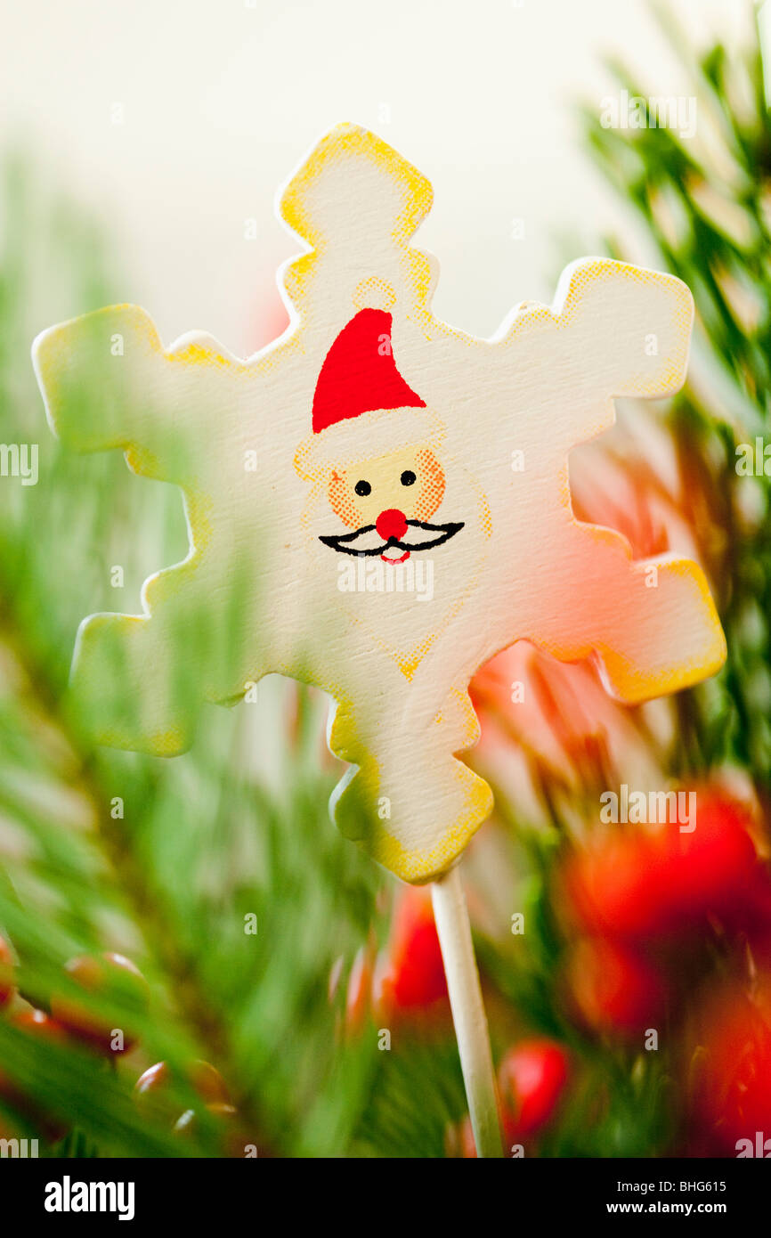 christmas decoration amongst branches - Stock Image