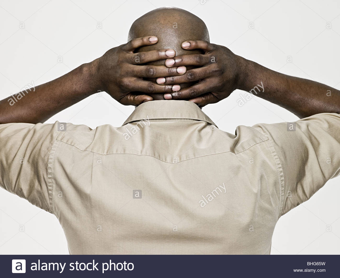 Rear view of a bald man - Stock Image