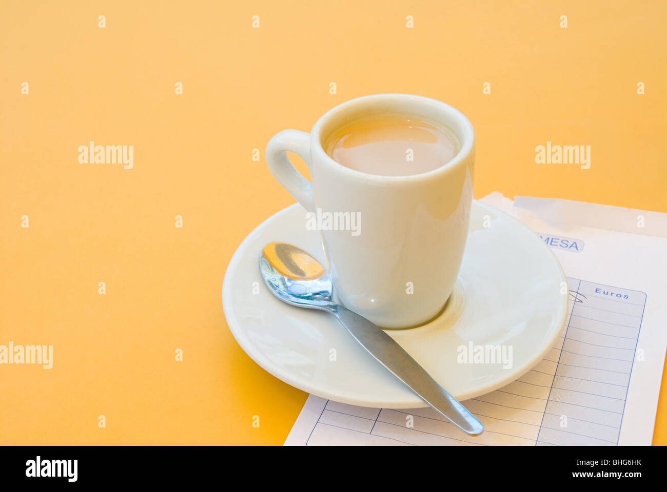 Coffee cup and bill - Stock Image
