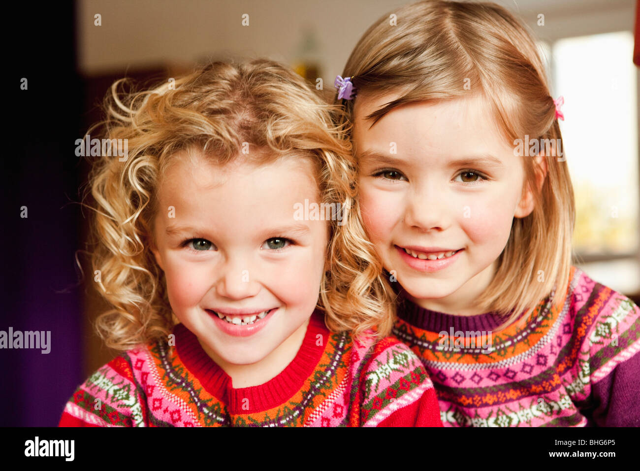 young girls smiling at viewer - Stock Image