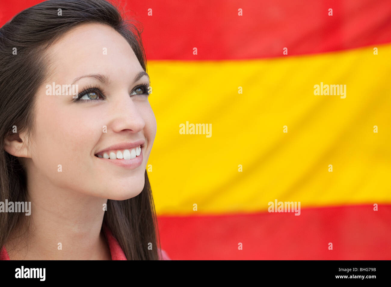 Young woman and spanish flag - Stock Image