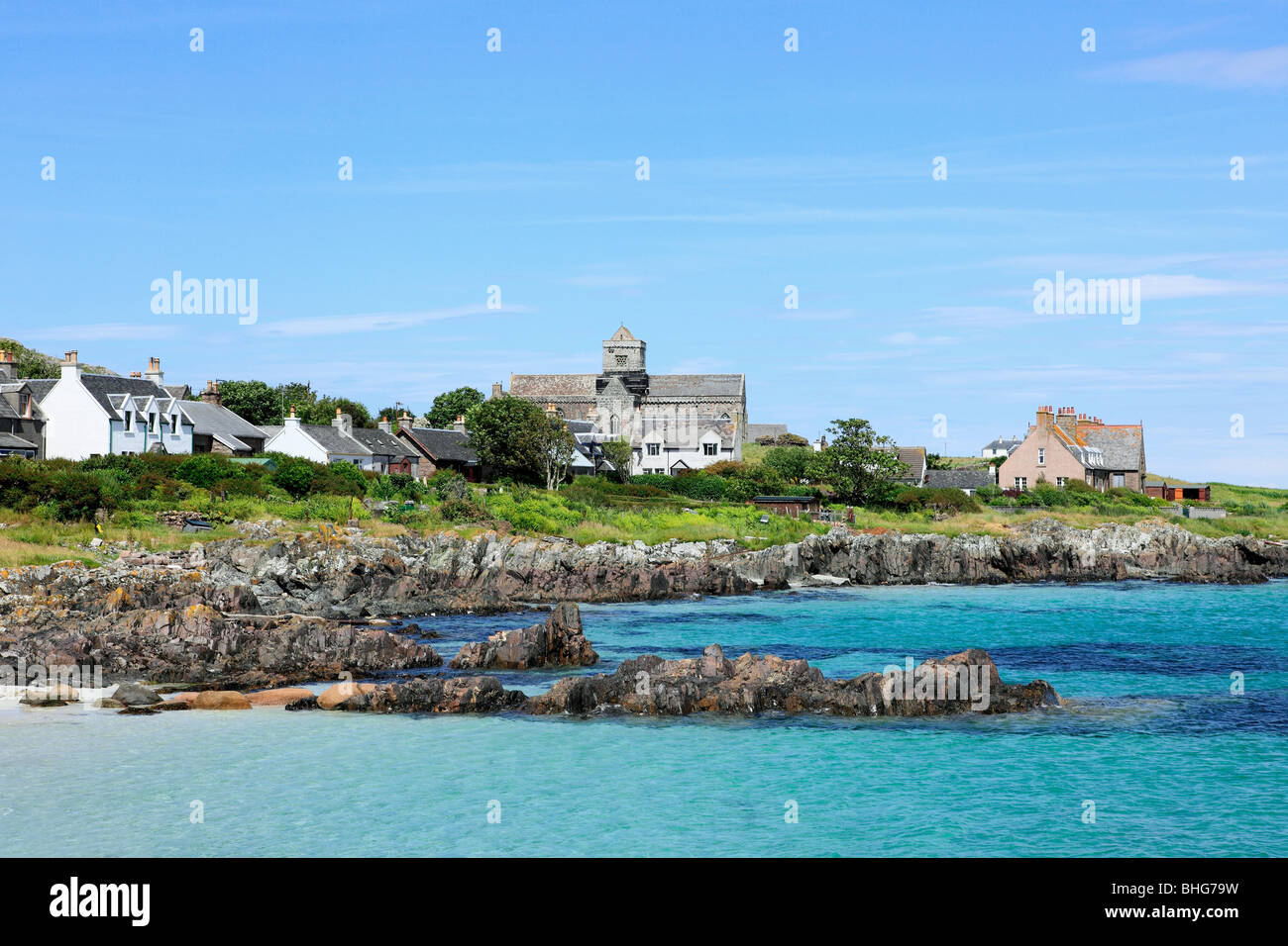 Coast of iona with view of abbey - Stock Image
