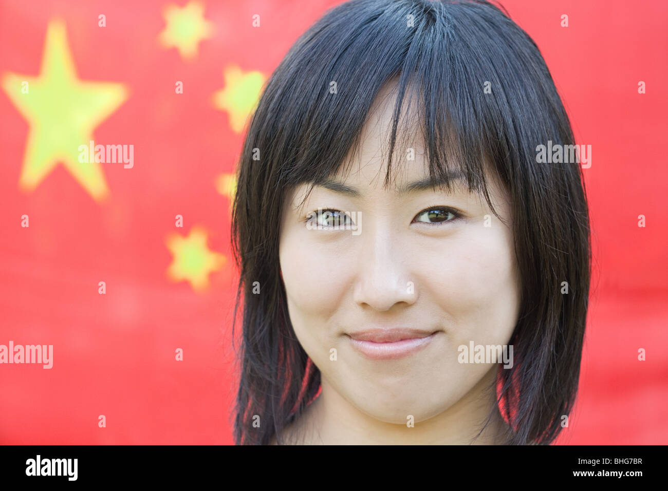 Woman and chinese flag - Stock Image