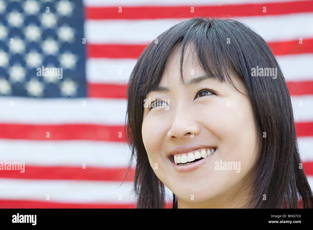 Woman and american flag - Stock Image