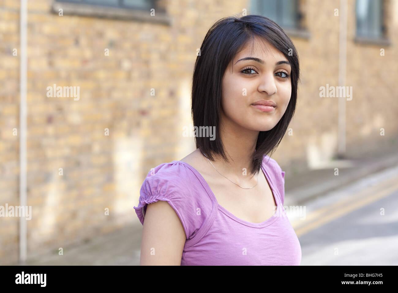 Portrait of teenage girl in street Stock Photo
