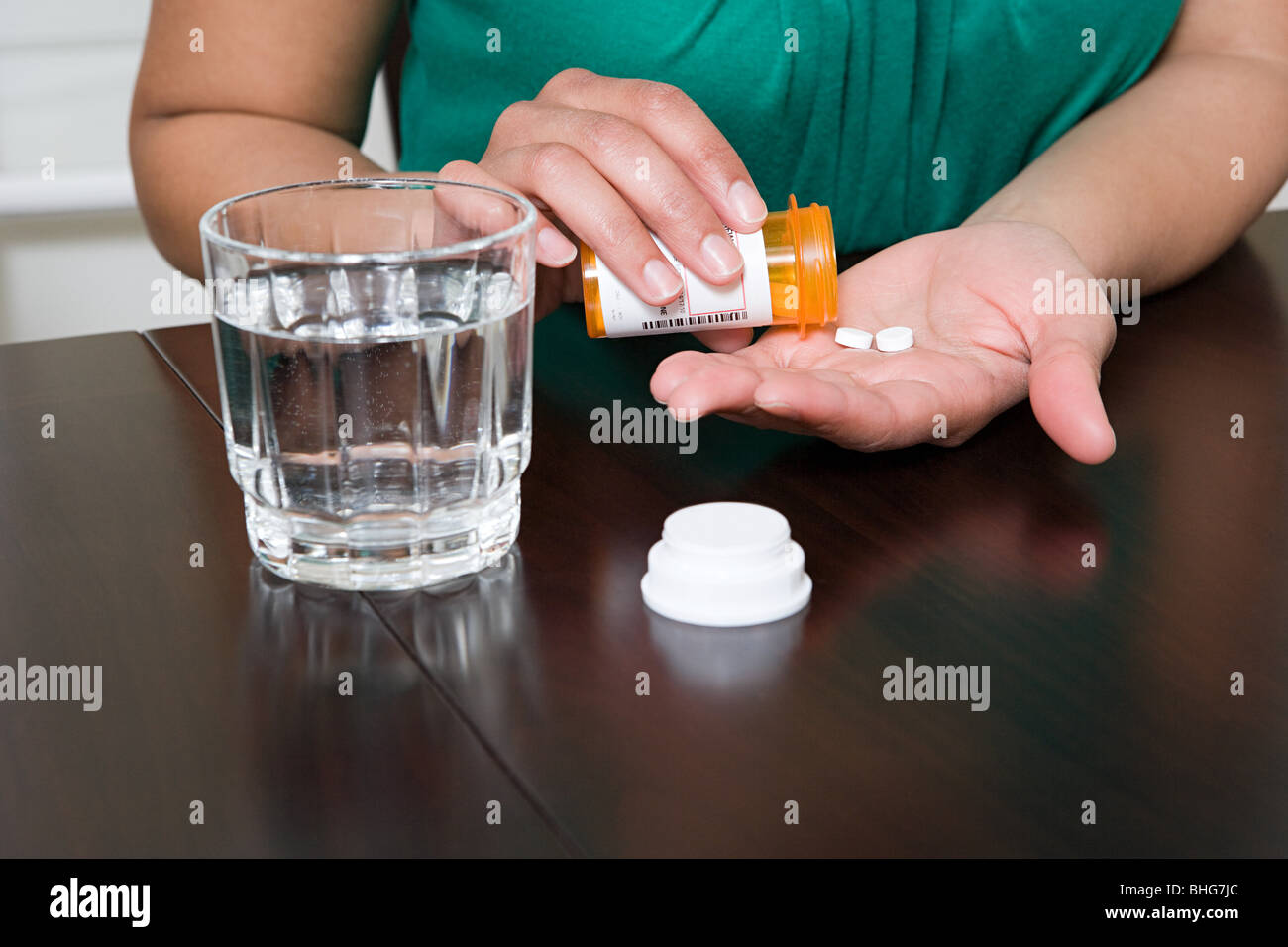Woman taking tablets - Stock Image