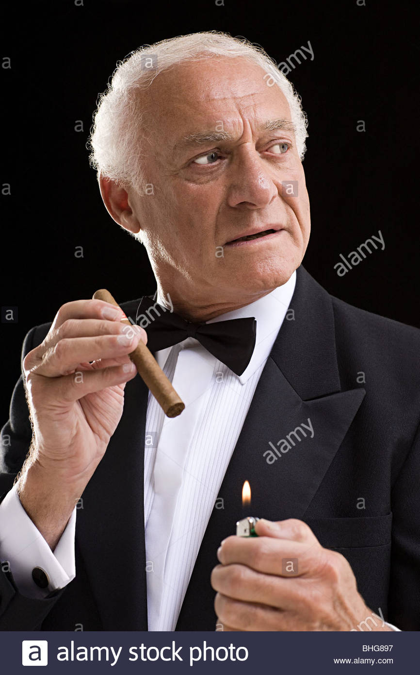 Man in dinner jacket with cigar - Stock Image