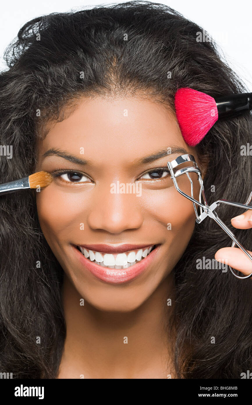 Woman having makeup done - Stock Image