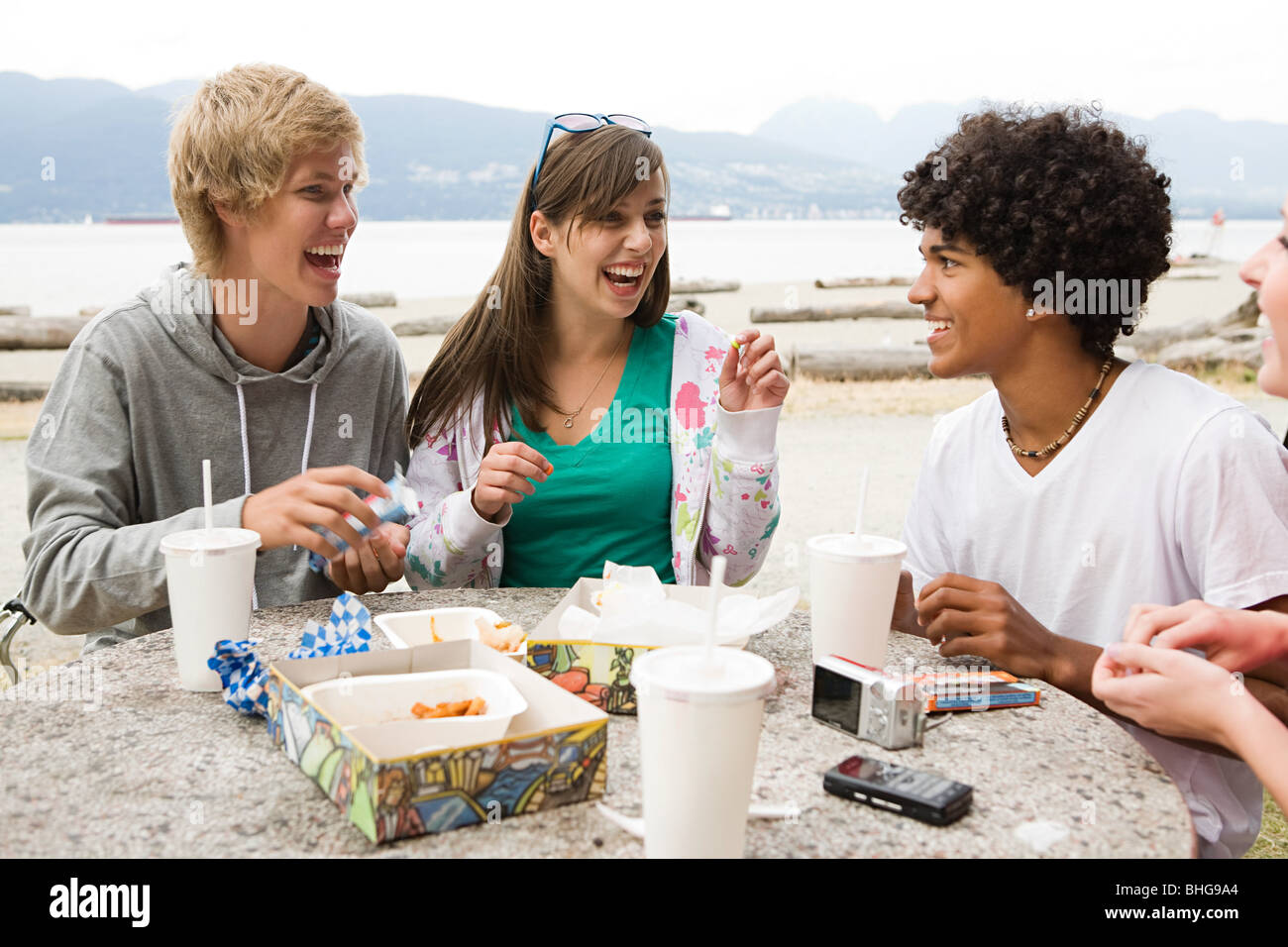 Teenagers with fast food - Stock Image
