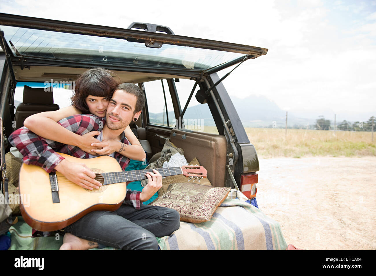 Young couple with guitar - Stock Image