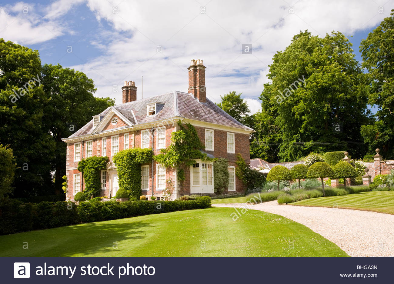 An English Queen Anne Country House Or Manor Approached By A Sweeping Gravel Drive In England UK