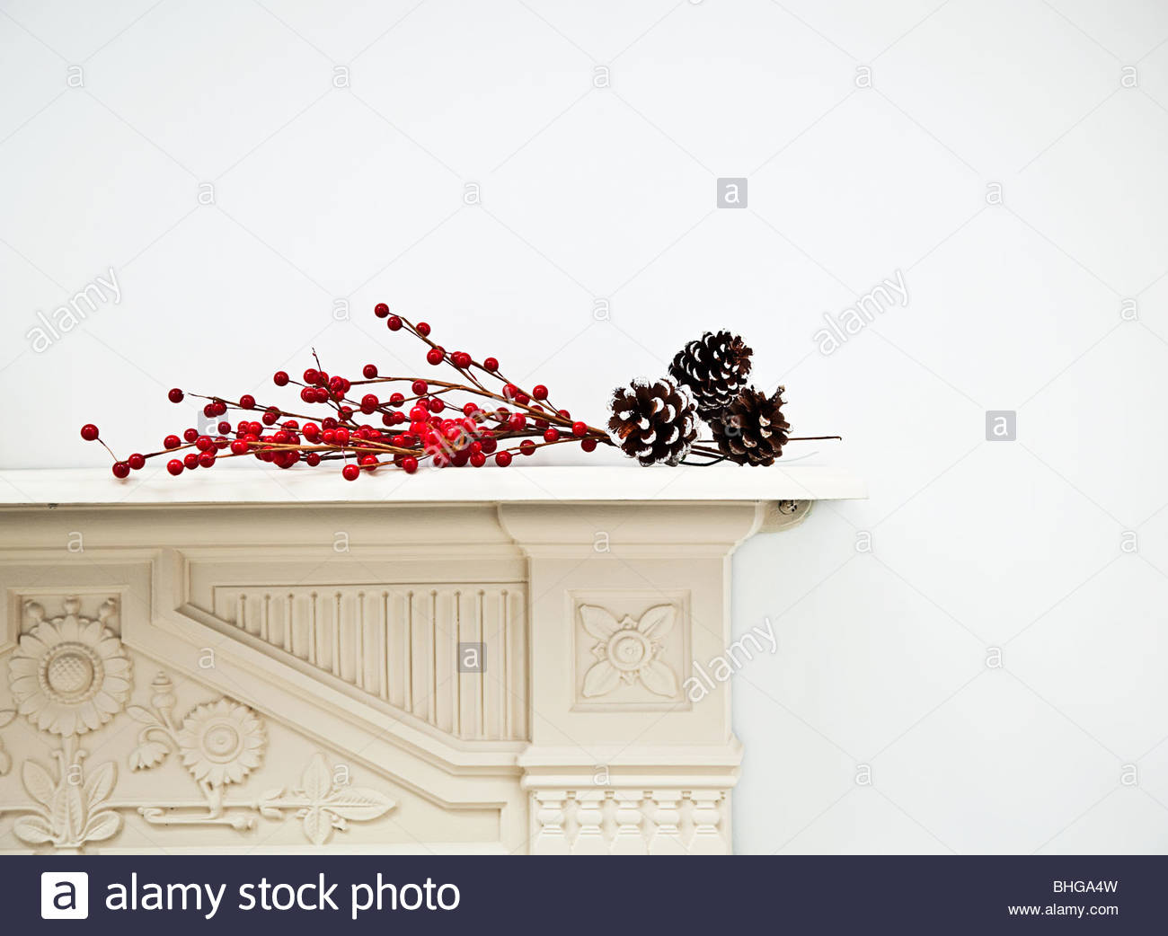 Festive decoration on mantlepiece - Stock Image