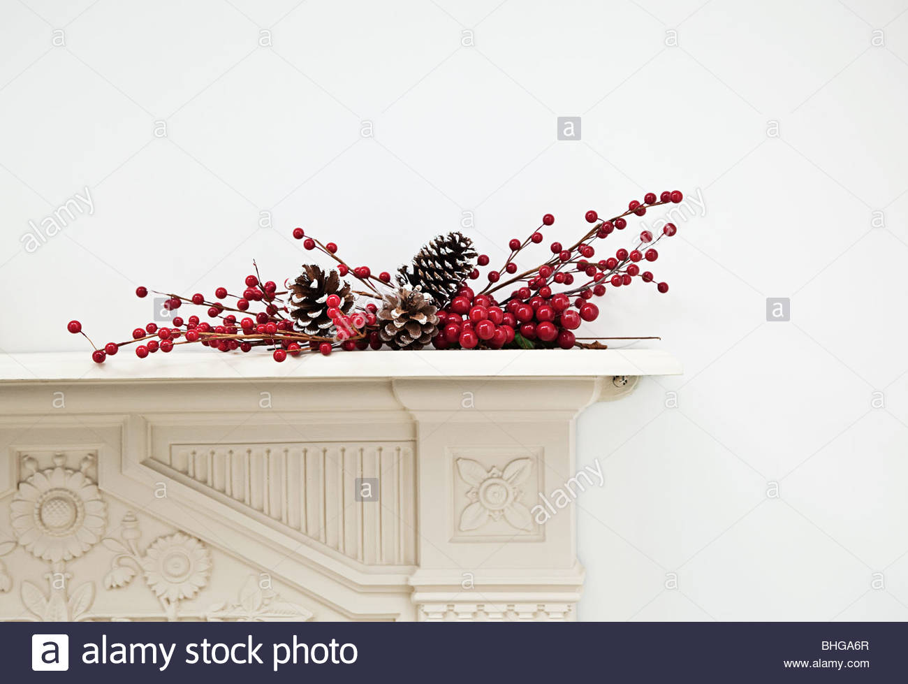 Festive display on mantlepiece - Stock Image