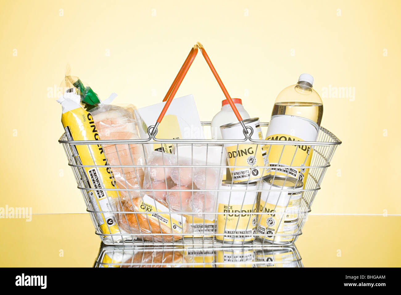 Basket of basic groceries - Stock Image