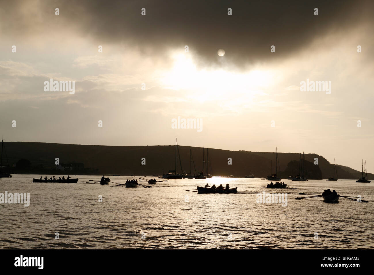 Gig boats at the end of a race in the Isles of Scilly, Cornwall UK. - Stock Image